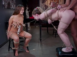 One kinky guy enjoys fucking two tied up babes with big asses